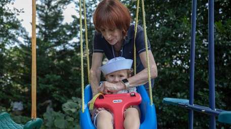 Helene Rudin at the playset with grandson Jack