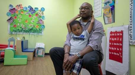 Alestair Patterson, 42, with his son Adin Patterson,