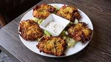 Mucver, or zucchini pancakes, are pan fried with