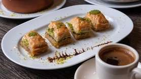 Baklava soaked in sweet syrup and dusted with