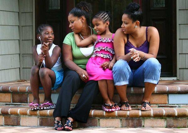 From left, Kaydi McMillan, 7, Genelle Guzman-McMillan, Kellie