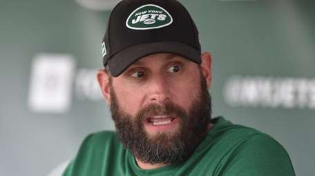 Jets head coach Adam Gase speaks with the