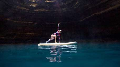You can try stand-up paddleboard yoga inside a
