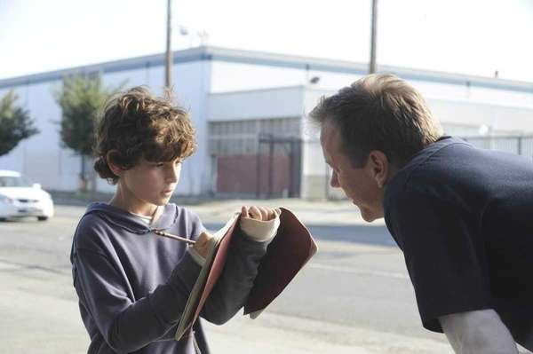 Actor Kiefer Sutherland speaks to costar David Mazouz