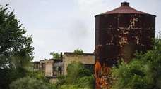 An abandoned building and a water tower on