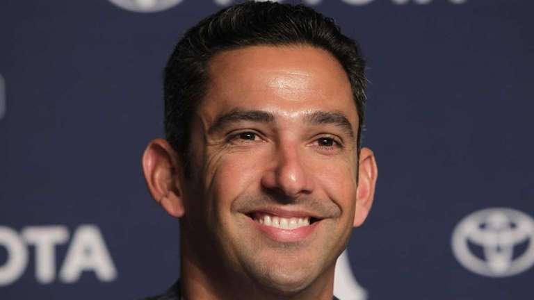Jorge Posada smiles during a news conference where