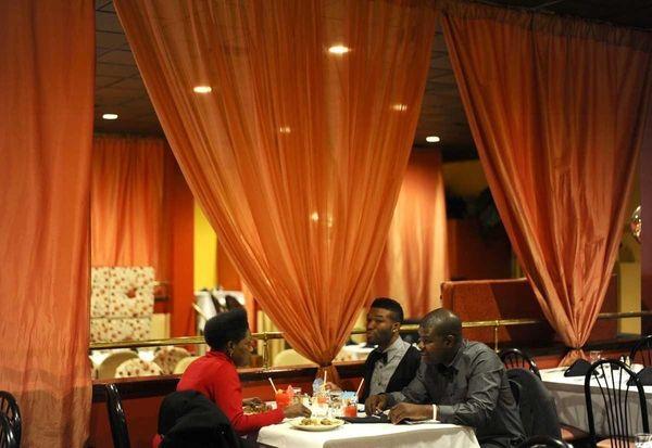 Patrons dine at Nakisaki, a Jamaican Chinese restaurant