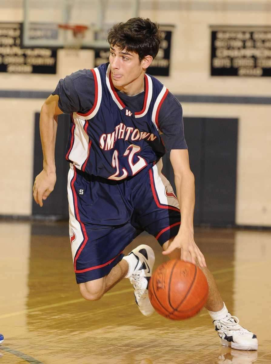 Smithtown West forward Tom Whalen drives the ball