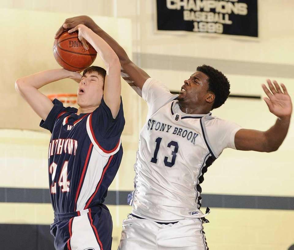 Smithtown West forward Mike Cohen is fouled by