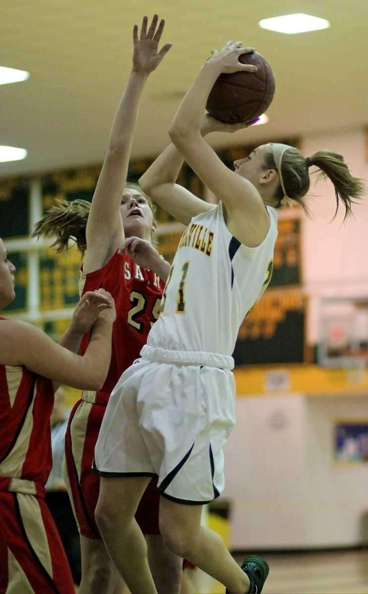 Ward Melville's Caysea Cohen tries to get the