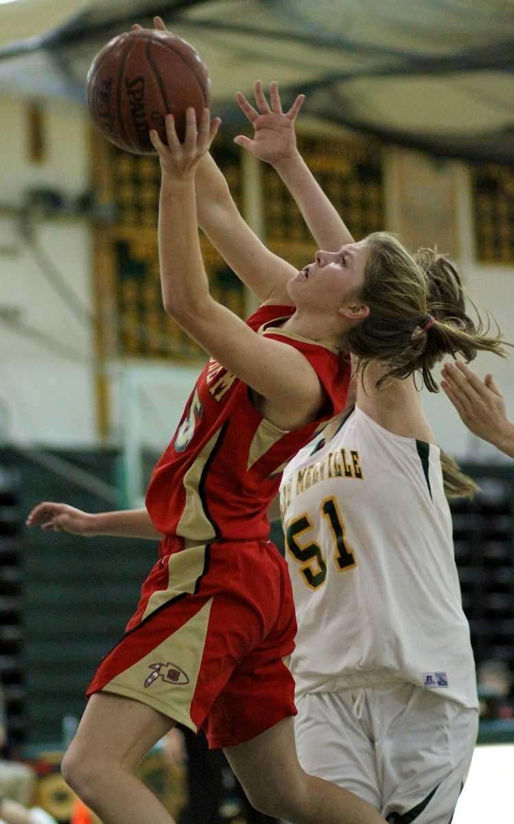 Sachem East's Katie Doherty drives the lane past