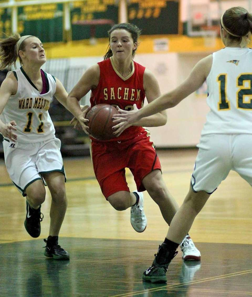 Sachem East Meagan Doherty drives past Ward Melville's
