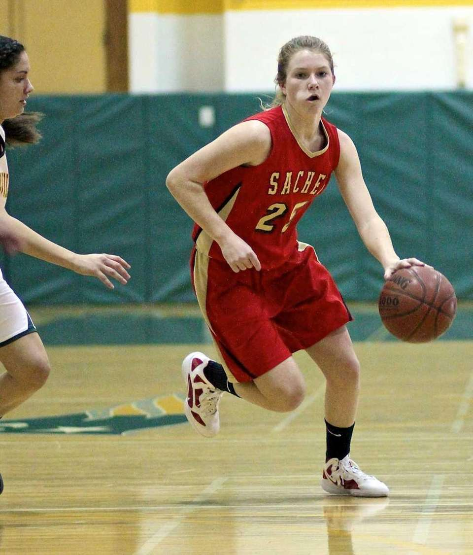 Sachem East's Katie Doherty moves the ball into
