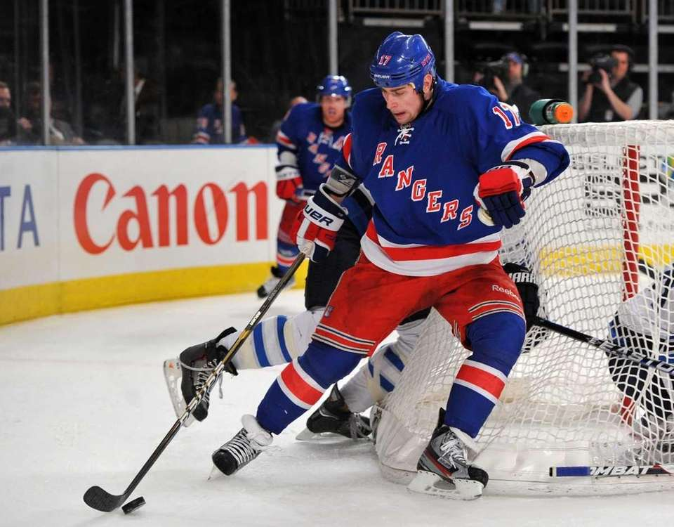 Brandon Dubinsky of the Rangers controls the puck