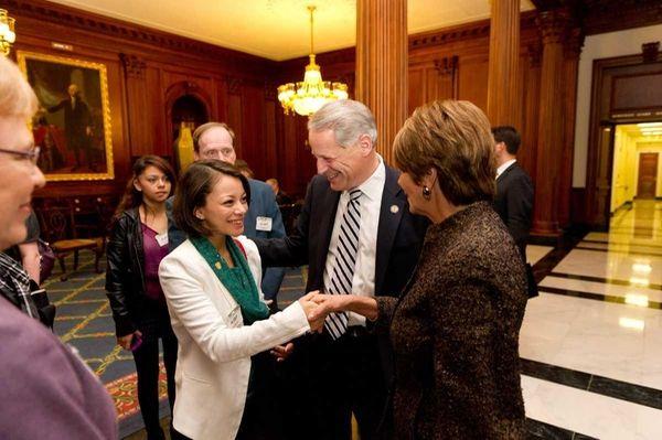 Rep. Steve Israel, center, introduces Samantha Garvey, left,