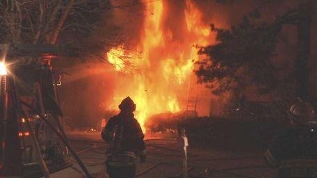 Two volunteer firefighters were injured battling a fire