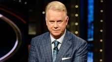 Boomer Esiason, left, and Phil Simms talk during