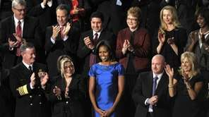 Guests applaud first lady Michelle Obama during President