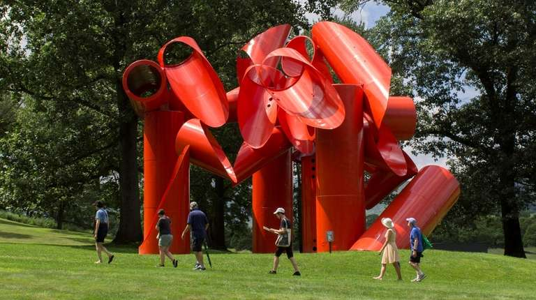 Visitors check out a sculpture titled Iliad by