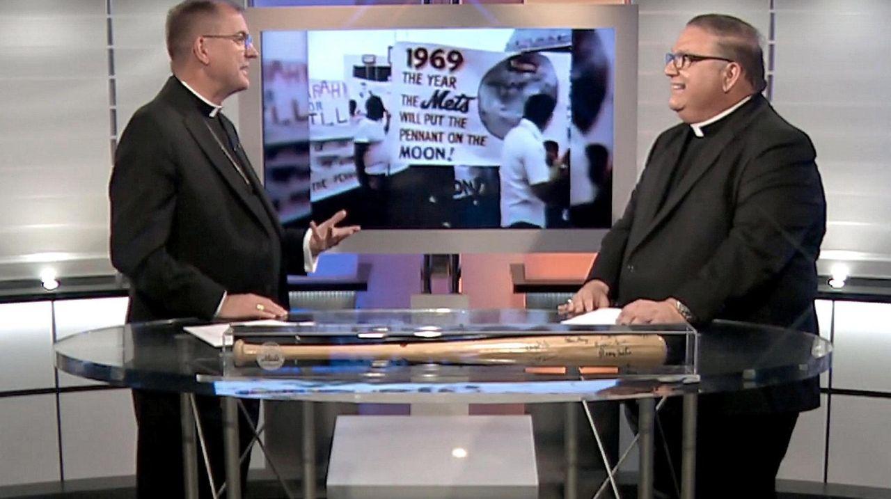 Bishop John Barres and Msgr. James Vlaun talk