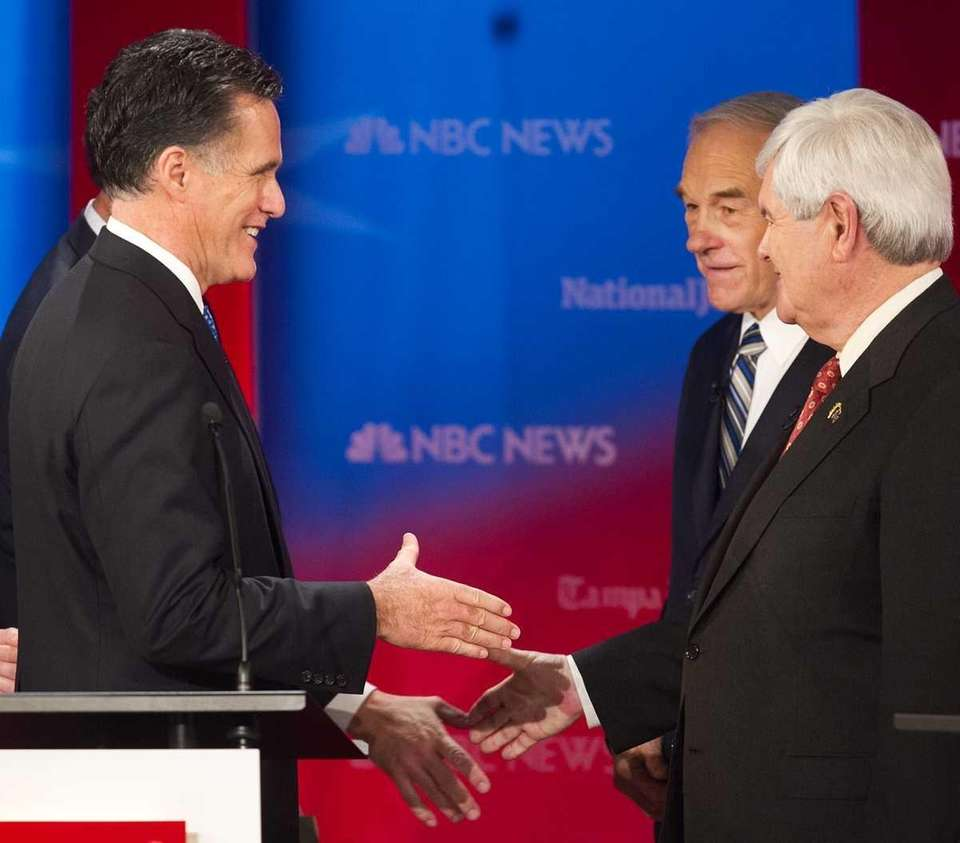 Republican presidential hopefuls Mitt Romney, left, Newt Gingrich,