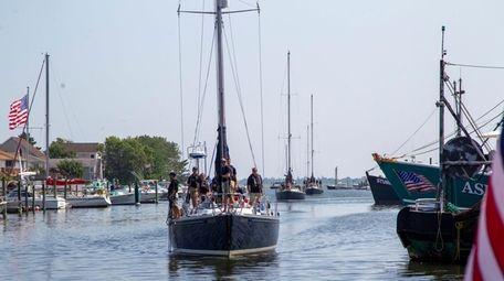 U.S. Naval Academy midshipmen arrive at the Nautical