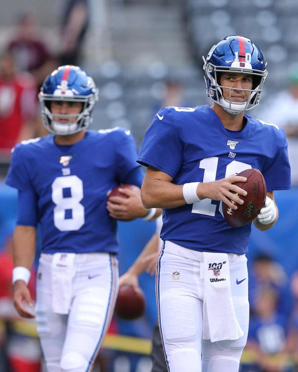 Eli Manning, right, had a three-and-out in his