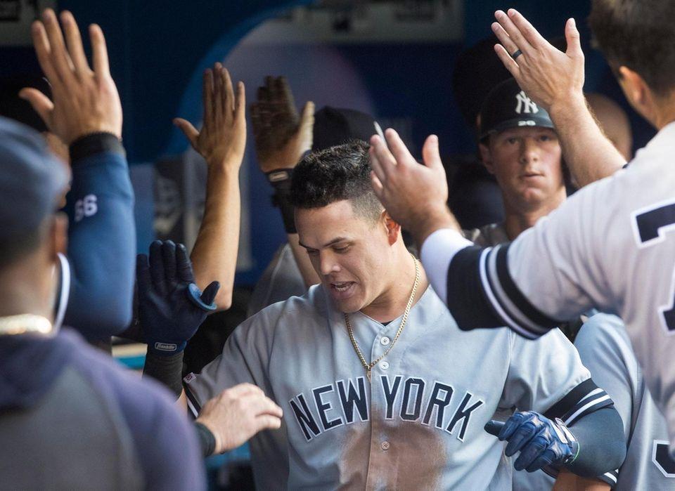 New York Yankees' Gio Urshela celebrates with teammates