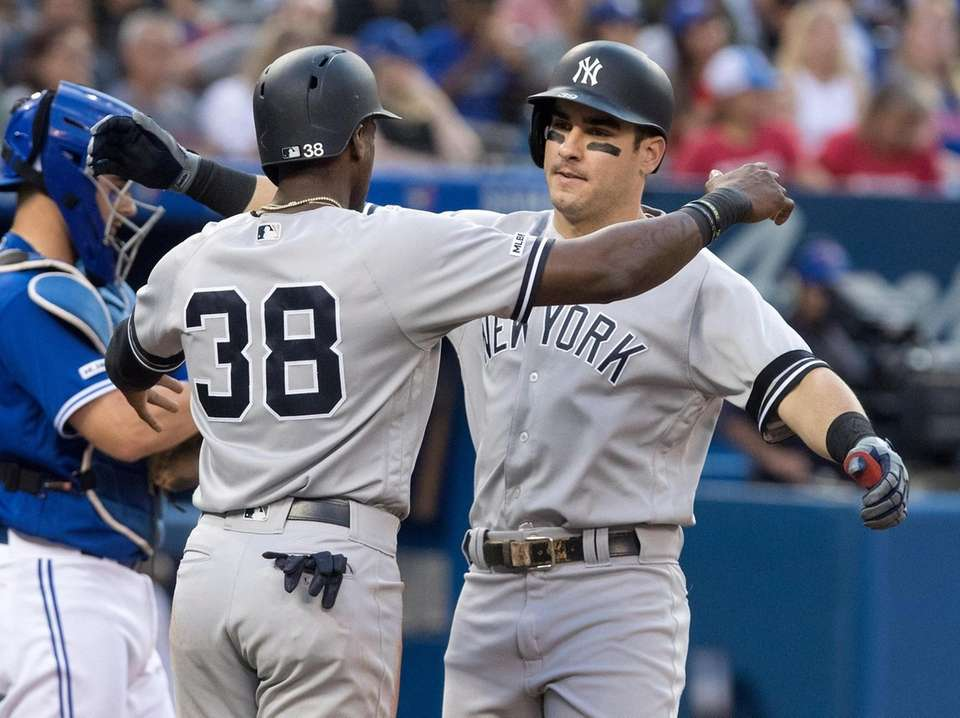 New York Yankees' Mike Tauchman is greeted by