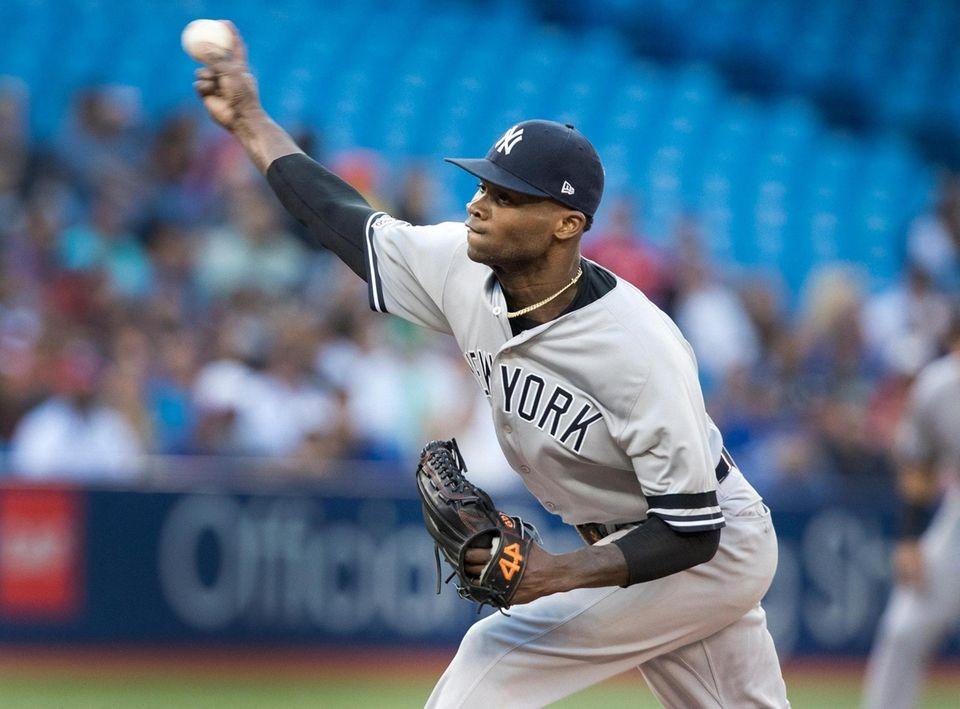 New York Yankees starting pitcher Domingo German throws