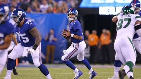 New York Giants quarterback Daniel Jones (8) drops