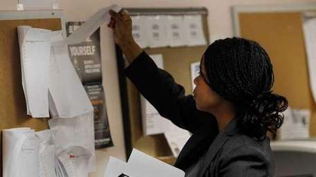 A job-seeker looks over job listings at NYS