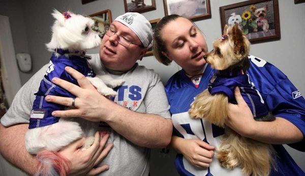 Dog groomers James and Megan Senn show their