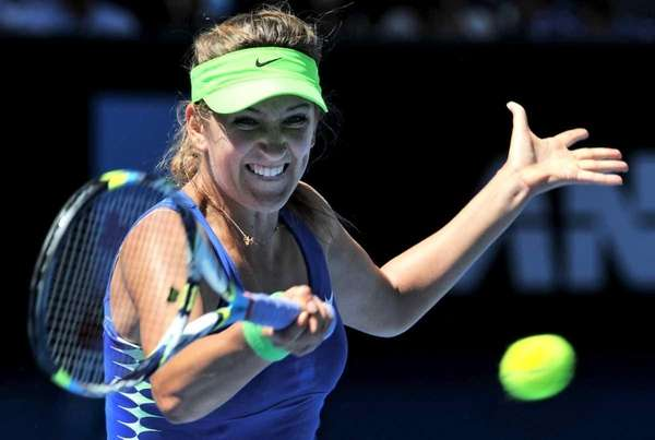 Victoria Azarenka hits a return against Kim Clijsters