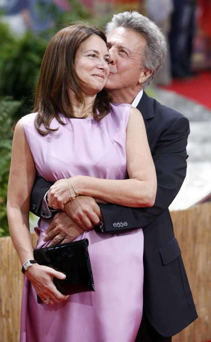 U.S. actor Dustin Hoffman, right, kisses his wife