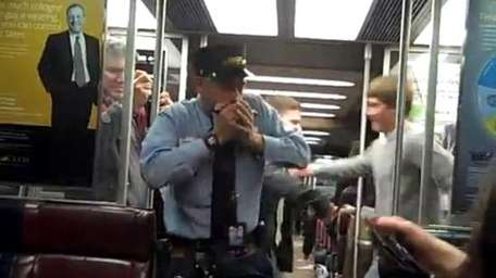This Metro-North Railroad conductor is seen in a