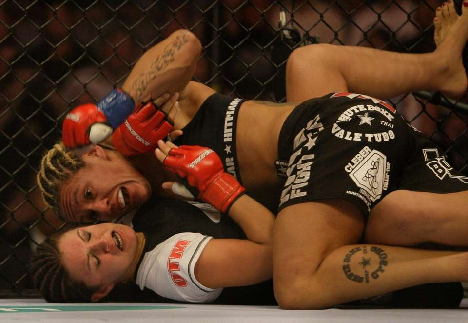 "Cris ""Cyborg"" Santos, of Brazil, top, fights Gina"