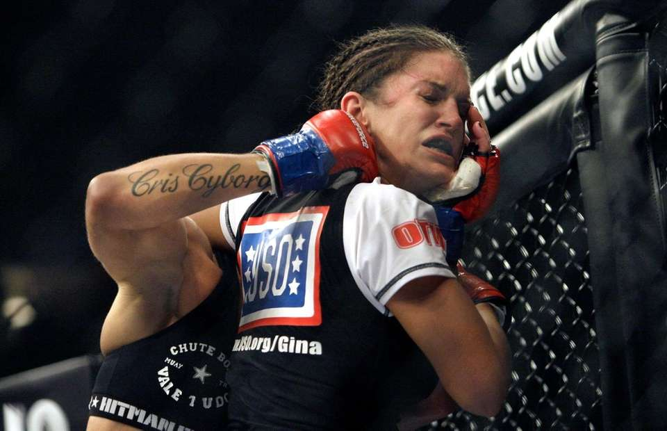 "Gina Carano, right, is punched by Cris ""Cyborg"""