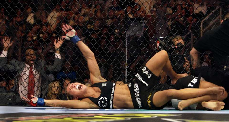 "Cris ""Cyborg"" Santos, of Brazil, celebrates after beating"