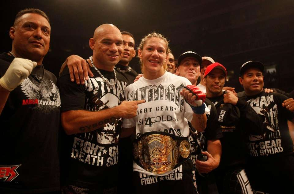 "Cris ""Cyborg"" Santos, of Brazil, center, celebrates with"