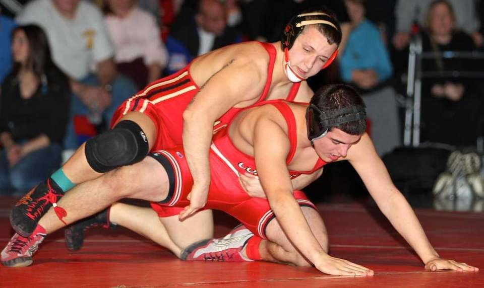 Sachem East's Zac Nobre (top) attempts to pin
