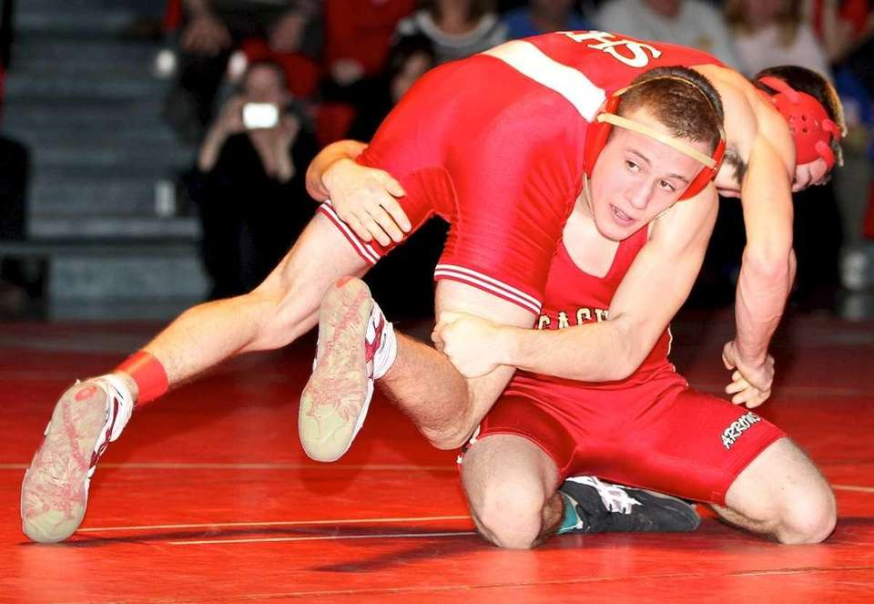 Sachem East's Jackson Mordente goes for the takedown