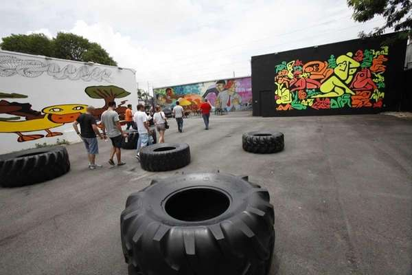 A tour group walks through the Wynwood Walls