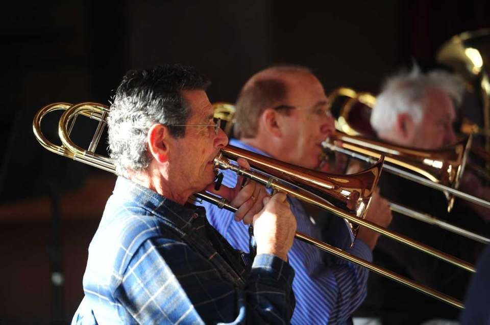Members of the Senior Pops Orchestra play during