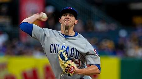 Brad Brach, pitching for the Cubs in July,