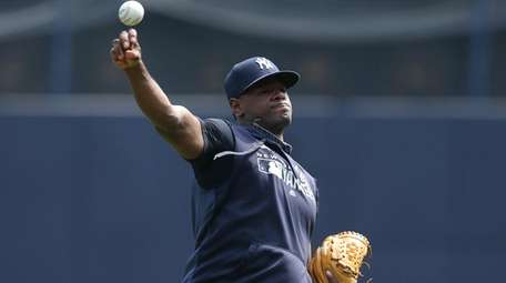 Luis Severino, throwing in the outfield at Yankee