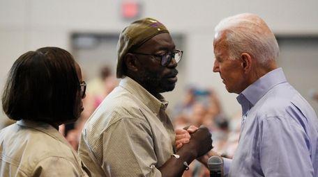 Former Vice President Joe Biden with Tyrone Sanders,