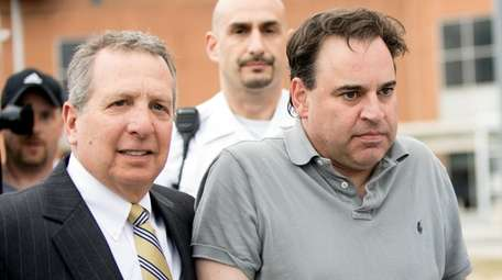 Suffolk County District Judge Robert Cicale, right, is