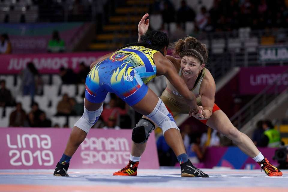 Jenna Burkert of the U.S., right, grapples with