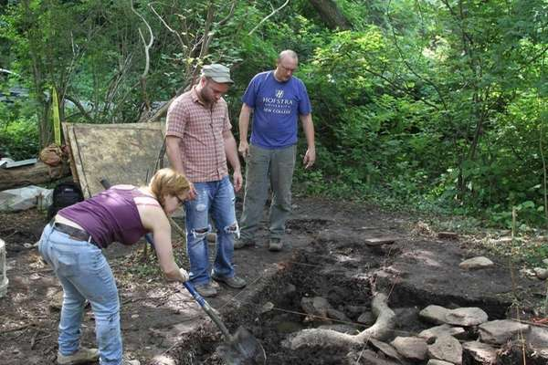 Archaeologist and Hofstra University professor Chris Matthews, right,